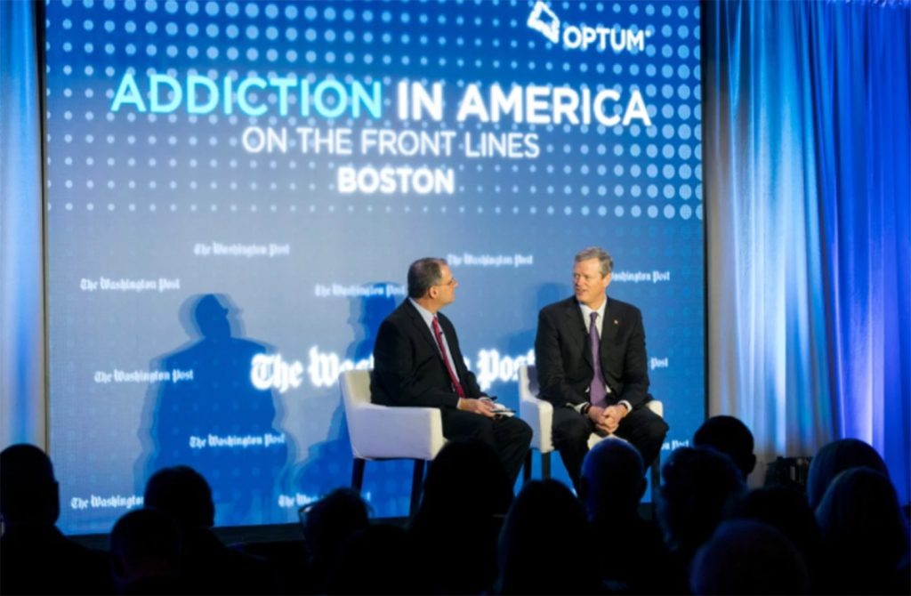 Massachusetts Gov. Charlie Baker, right, discusses the opioid crisis with Lenny Bernstein, a reporter for The Washington Post, on Thursday in Boston.
