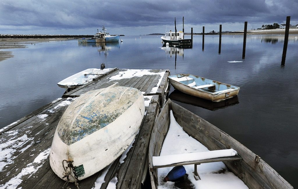 Storm clouds roll in over dinghies tied up at docks along the Saco River in Camp Ellis.