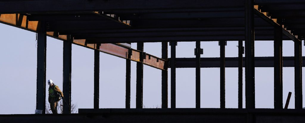 A worker with Cianbro works on the second floor of an office building under construction on Monday, January 29, 2018 on the Portland waterfront. Staff Photo by Gregory Rec