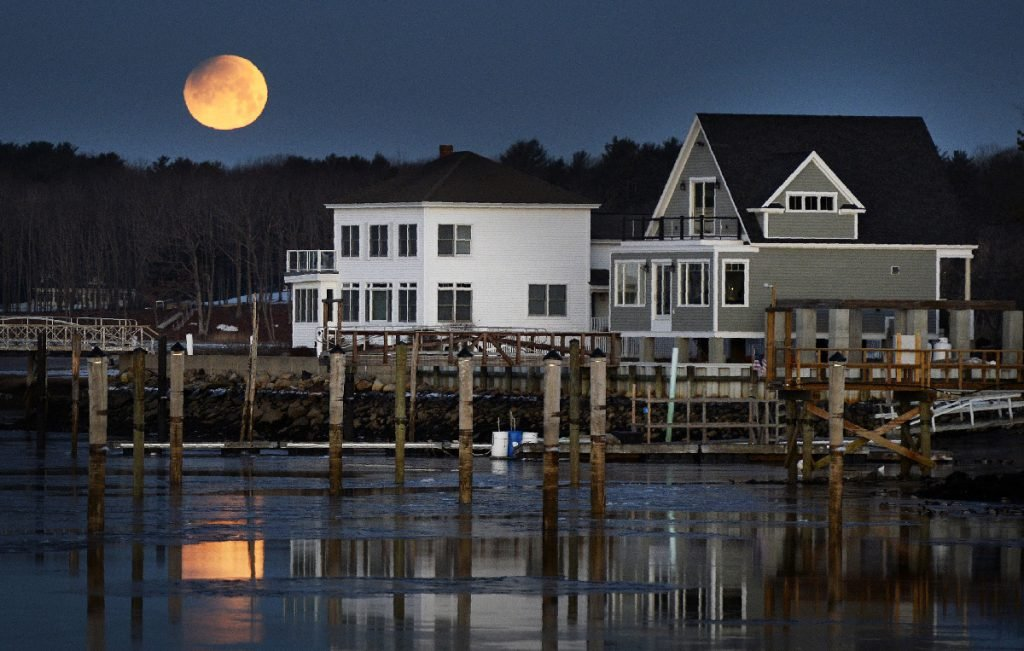A super blue moon sets over over the Saco river in Camp Ellis at the start of it's eclipse Wednesday, January 31, 2018. Staff photo by Shawn Patrick Ouellette