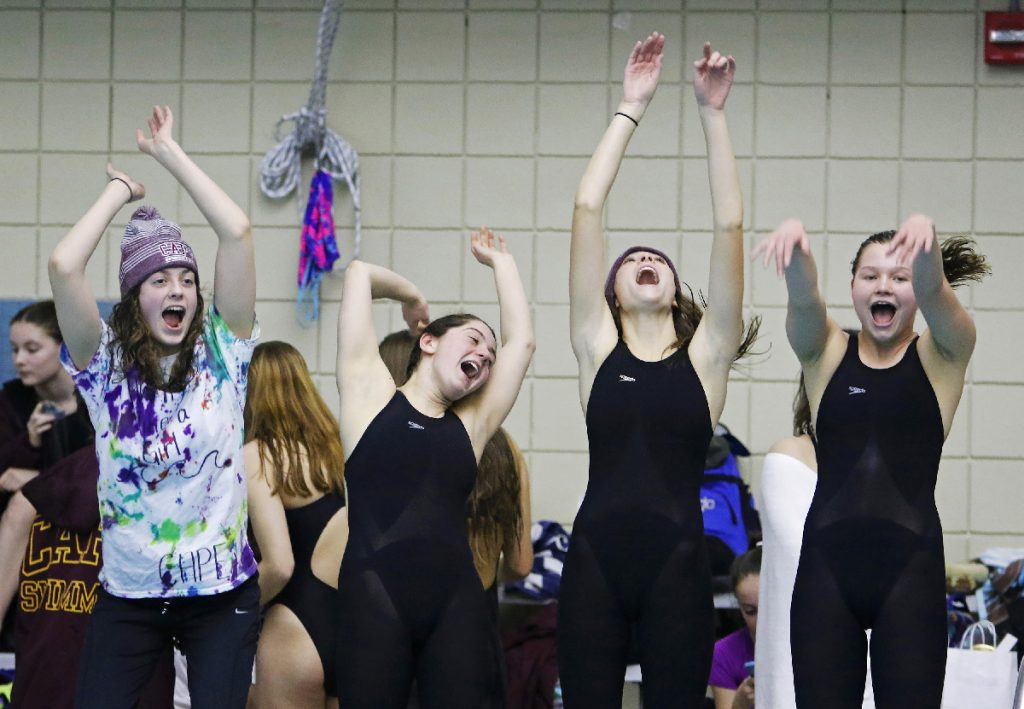 Cape Elizabeth teammates Olivia Tighe, Maddie McCormick, Corinne Wight and Hope Campbell burn off some excitement early in the Maine HIgh School Girls Class B State Swimming and Diving Championships at Bowdoin College on Monday, February 19, 2018. Staff photo by Jill Brady