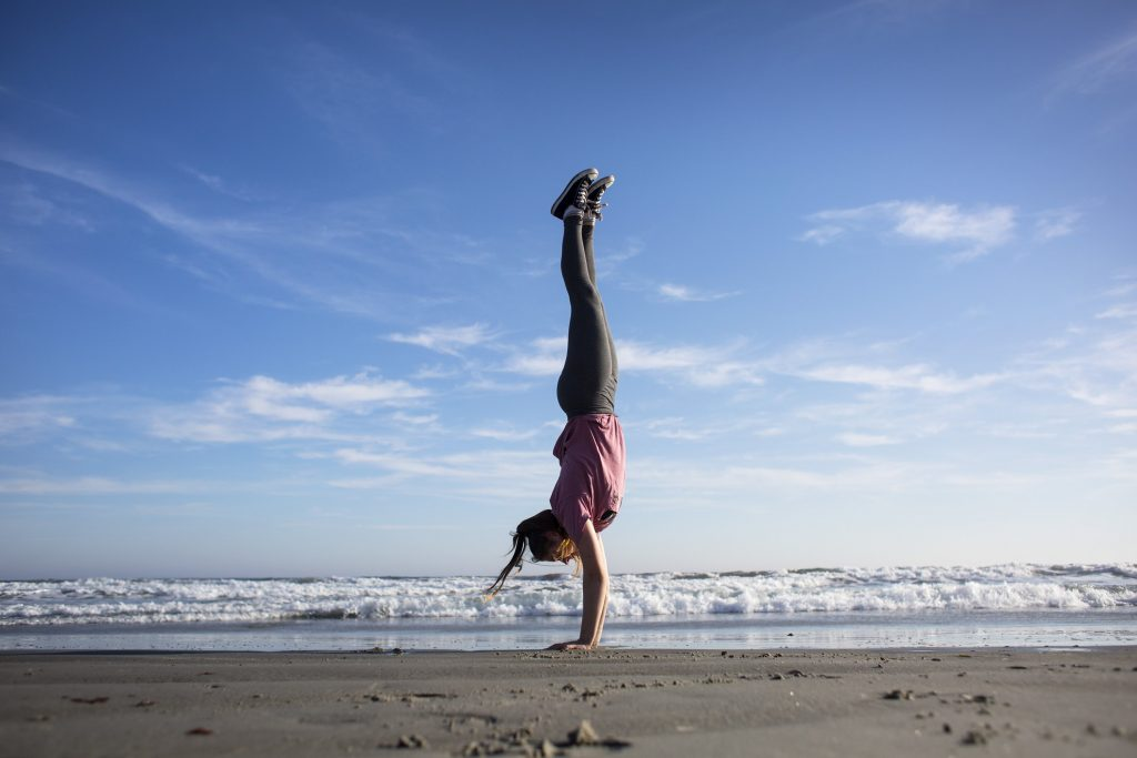When Anna Malone, 15, of South Portland did handstands at Higgins Beach a week ago the weather was in the mid-60s.  Yesterday, it hit 57 degrees according to timeanddate.com. Today, the high is predicted to be 50 degrees.