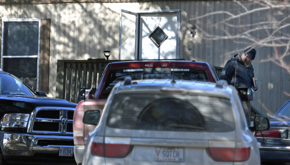 "Maine State Police investigators examine the scene of the home at 946 Post Road in Bowdoinham, where police say 55-year-old Beulah ""Marie"" Sylvester was found with severe injuries Monday morning. She later died at Maine Medical Center."