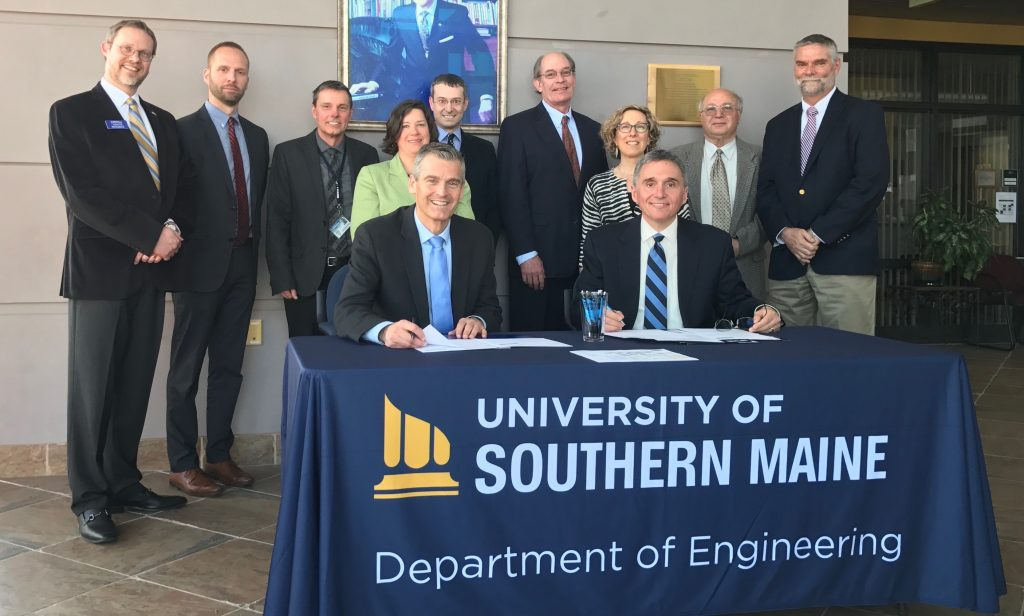 University of Southern Maine President Glenn Cummings, seated left, and Southern Maine Community College President Ron Cantor are joined by the chairs of both schools' engineering departments – USM's Mariusz Jankowski, third from left, and SMCC's Adam Tambone, center  – at the signing of the schools' 2 + 2 program agreement in April 2017. Also shown, from left rear, are USM's Carlos Lück, associate professor of electrical engineering; Andrew King, admissions director; Meghan Cadwallader, educational partnerships director; James Graves, dean of the College of Science, Technology and Health; Jeannine Uzzi, provost; and Mustafa Guvench, professor of electrical engineering. At right is Charles Gregory, SMCC interim dean of academics.