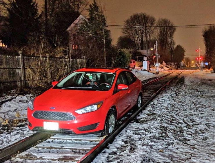 The car got stuck on the tracks between Lincoln and Coyle streets.