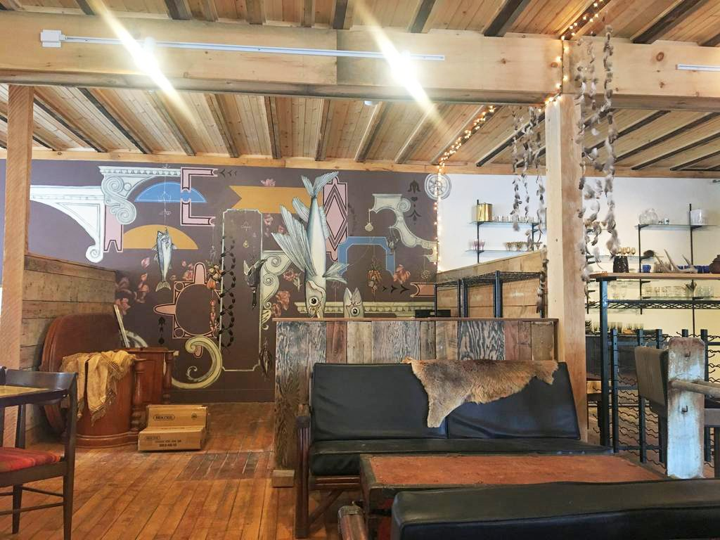 Much of Vessel and Vine's interior consists of items sourced by Iacono, such as tables from a Chinese restaurant in Lewiston and a mattress frame hanging from the ceiling. Iacono's friend Yennika Ekstrand painted the mural on the wall.