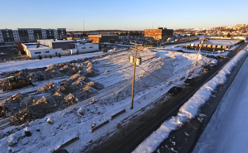 The developer of a proposed housing and retail complex for these empty lots on Somerset Street has requested a permit to build an eight story parking garage at the eastern end of the property.