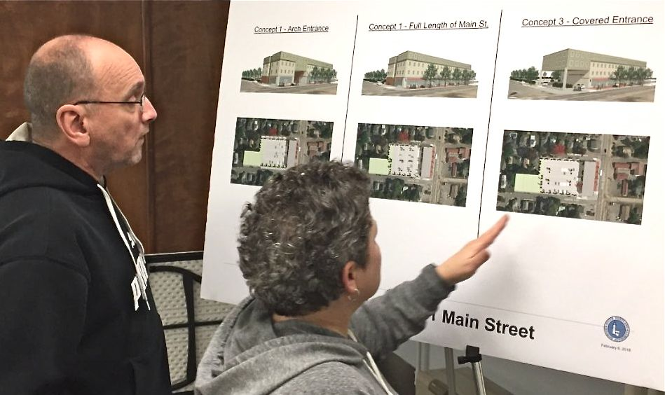 Aspen Avenue residents Phil and Gloria Carter review drawings in February for an affordable housing  building that the South Portland Housing Authority wants to build on Main St.