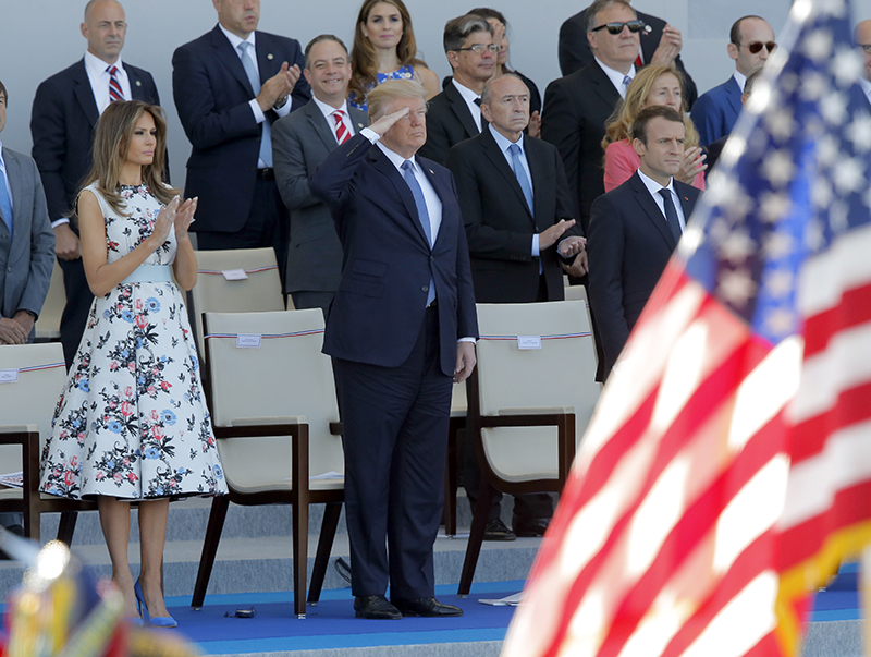 Donald and Melania Trump watch the traditional Bastille Day military parade  with French President Macron on the Champs Elysees, in Paris in 2017.