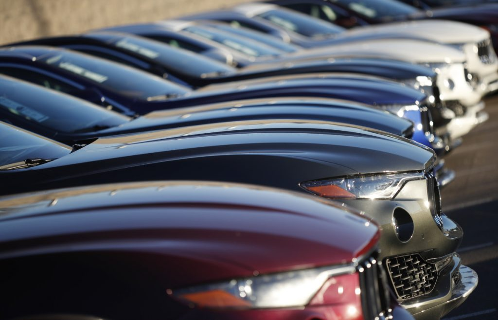 February auto sales fell from a year ago as automakers eased up on cash discounts and other incentives.
