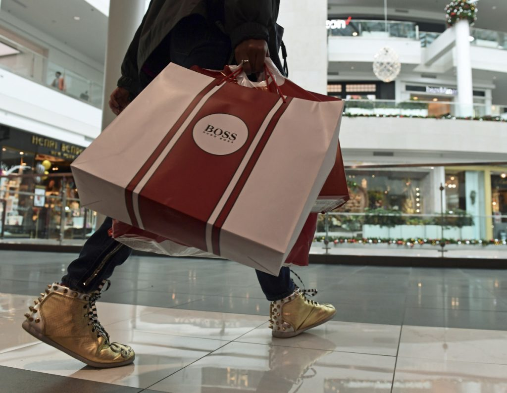 People shop at the Pentagon City Mall in Arlington, Va., in December. The Commerce Department issued its January report on consumer spending Thursday.