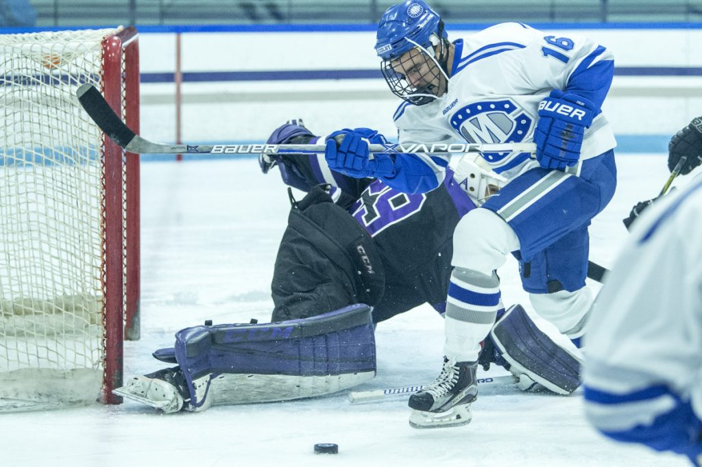 Colby College's Kienen Scott (16) tries to score on Amherst College goalie Connor Girard (29) last month at Colby College in Waterville.