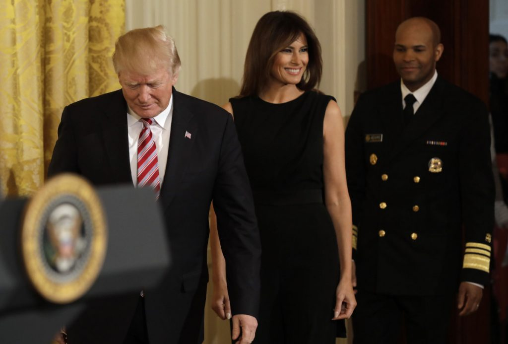 President Trump, First Lady Melania Trump and Vice Adm. Jerome Adams, the U.S. Surgeon General, arrive for a National African American History Month reception in Washington last month. Melania Trump received a green card in 2001. Left, Melania Trump's parents, Amalija Knavs and Viktor Knavs arrive with the Trumps at the White House last year.