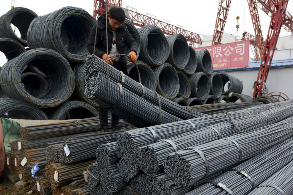 "A worker loads steel products onto a vehicle at a steel market in Fuyang in central China's Anhui province Friday, March 2, 2018. China has expressed ""grave concern"" about a U.S. trade policy report that pledges to pressure Beijing but had no immediate response to President Donald Trump's plan to hike tariffs on steel and aluminum. The Commerce Ministry said Friday that Beijing has satisfied its trade obligations and appealed to Washington to settle disputes through negotiation (Chinatopix Via AP)"
