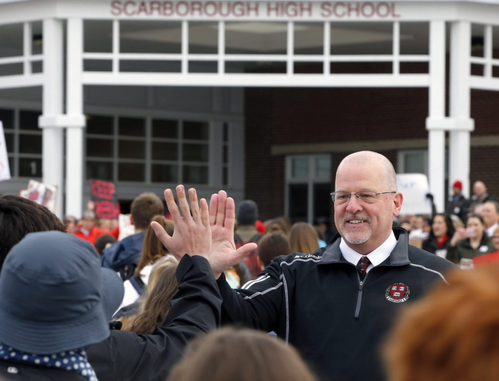 Principal David Creech greets students arriving at Scarborough High School on Monday. On Thursday, hundreds of people of packed a school board meeting in support of the embattled principal.