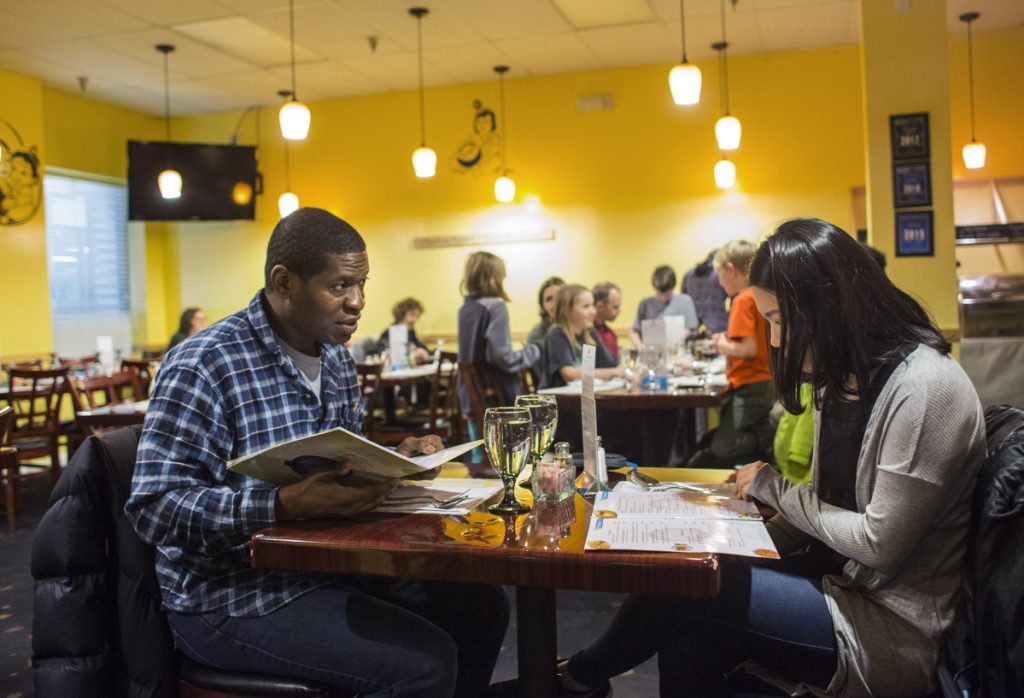 Tre Higgins of Williamsport, Pa., and Sun Park of Biddeford study their menus.