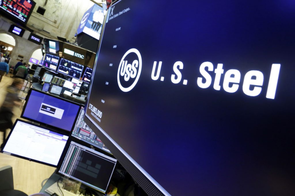 "The logo for U.S. Steel appears above a trading post on the floor of the New York Stock Exchange on Friday. President Trump on Friday insisted ""trade wars are good, and easy to win,"" a bold claim that will likely find many skeptics, including those on Wall Street and even some Republicans. (AP Photo/Richard Drew)"