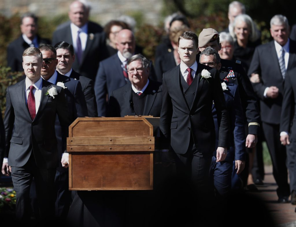 The casket of the Rev. Billy Graham is carried during his funeral service Friday.