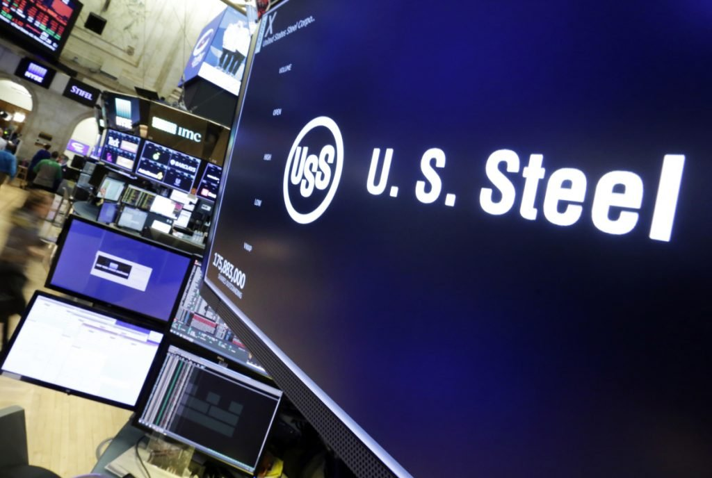 The logo for U.S. Steel appears above a trading post on the floor of the New York Stock Exchange on Friday. With his proposed tariffs the president has drawn the blueprints for the most protectionist U.S. trade policy in roughly 100 years