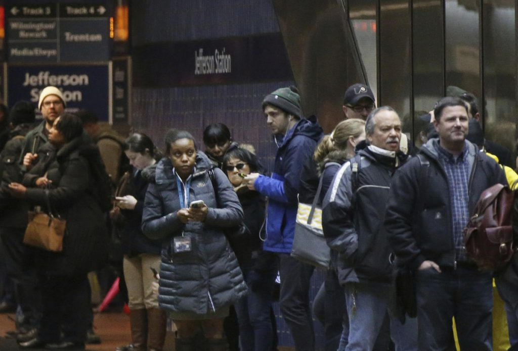 Passengers wait for SEPTA regional rail trains, most of which were suspended, in Jefferson Station in Philadelphia on Friday. Travel continued to be a challenge on Saturday.