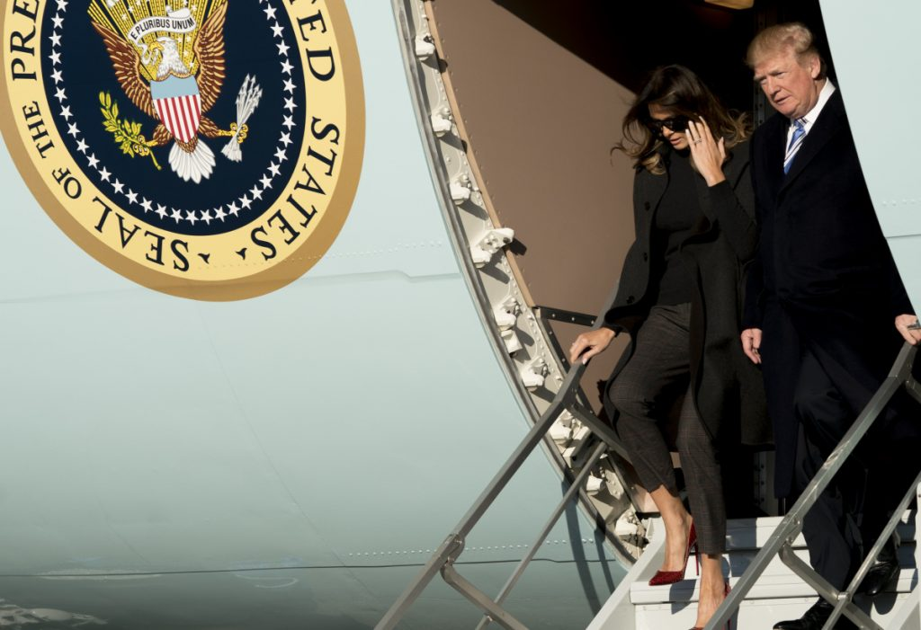 President Trump and first lady Melania Trump arrive at Andrews Air Force Base, Md., on Saturday to board Marine One for a short trip to the White House after visiting Mar-a-Lago.
