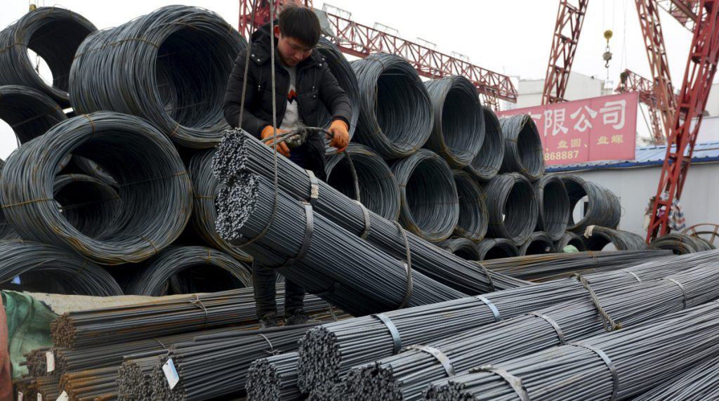 A worker loads steel products in Fuyang, China, on Friday, a day after President Trump shocked the world by saying the U.S. would impose a tariff of 25 percent on steel imports.