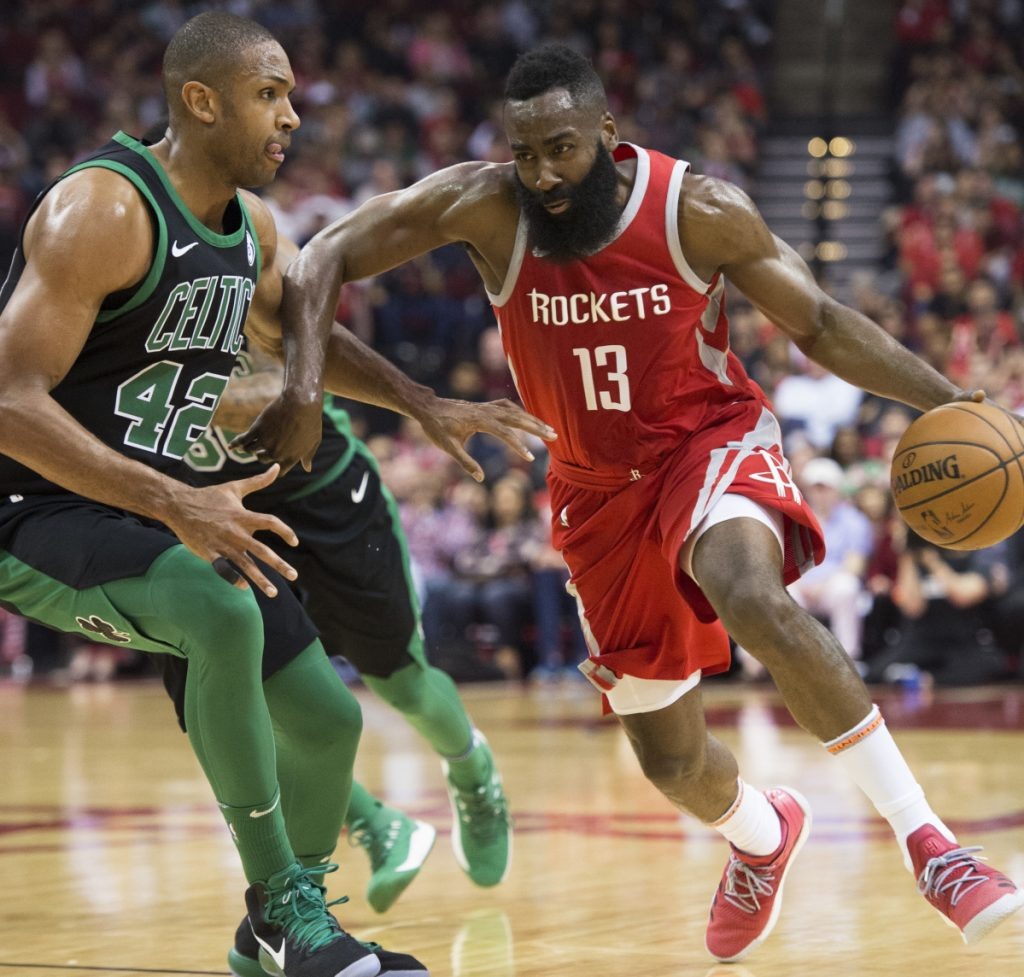 James Harden of the Houston Rockets attempts to drive past Al Horford of the Boston Celtics during Houston's 123-120 victory Saturday night. The Rockets have a 15-game winning streak.