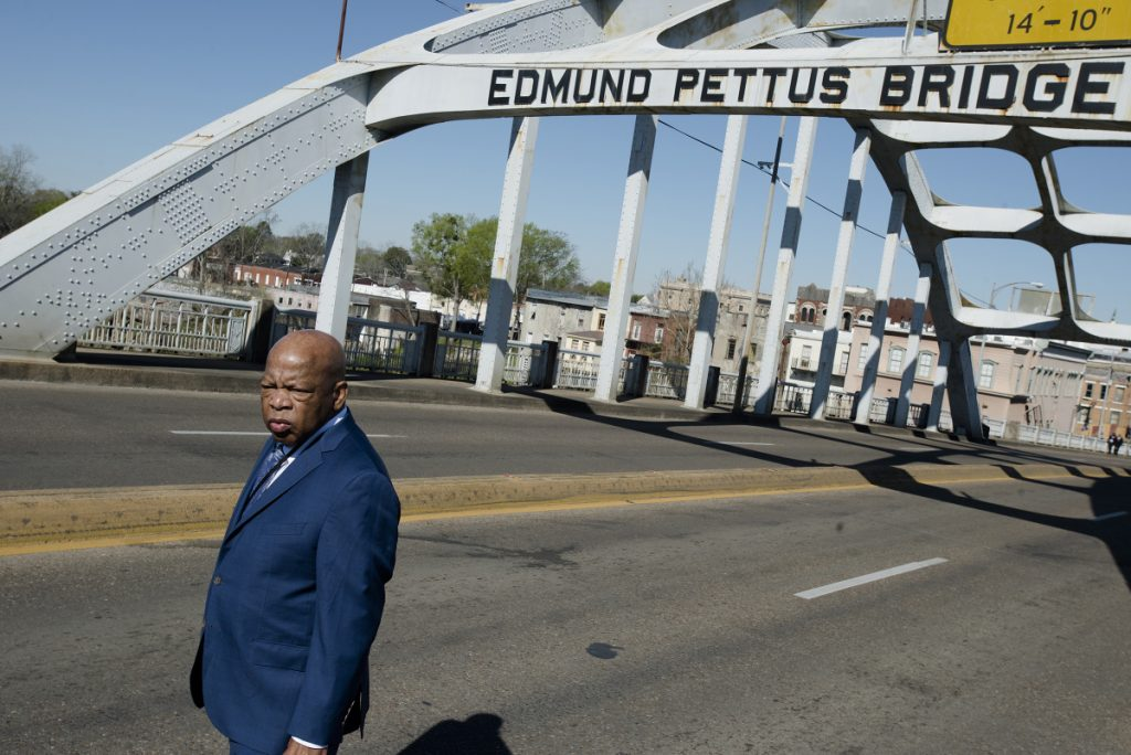 "Rep. John Lewis stands on the Edmund Pettus Bridge on Sunday in Selma, Ala., during the annual commemoration of ""Bloody Sunday,"" the day in 1965 when voting rights protesters were attacked by police as they attempted to cross the bridge."