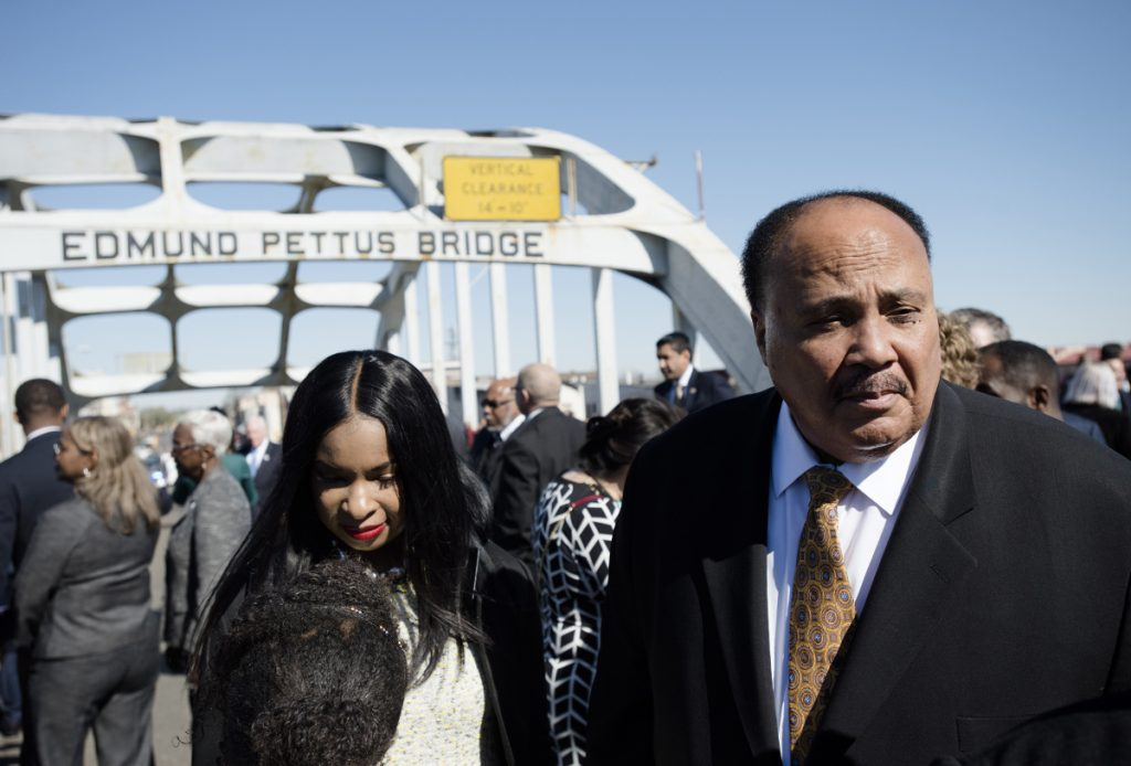 Martin Luther King III stands on the Edmund Pettus Bridge on Sunday in Selma, Ala.