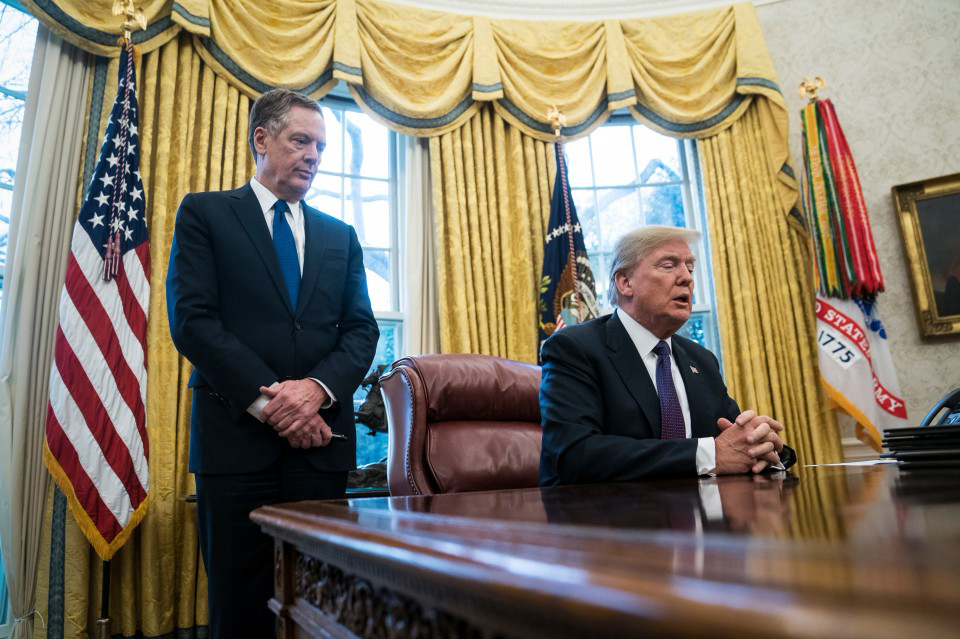 President Trump, with U.S. Trade Representative Robert E. Lighthizer, speaks in the Oval Office on Jan. 23.