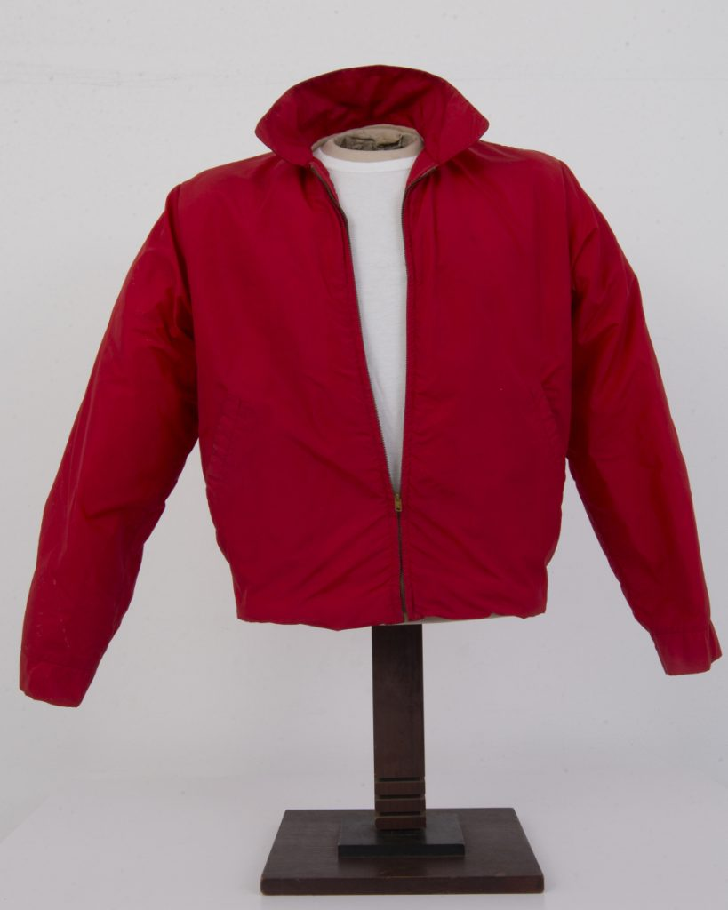 """The jacket worn by actor James Dean in the film """"Rebel Without a Cause"""" is shown on display."""