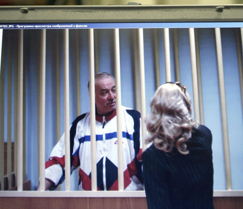 Sergei Skripal speaks to his lawyer from behind bars, as seen on the screen of a monitor outside a courtroom in Moscow in 2006.