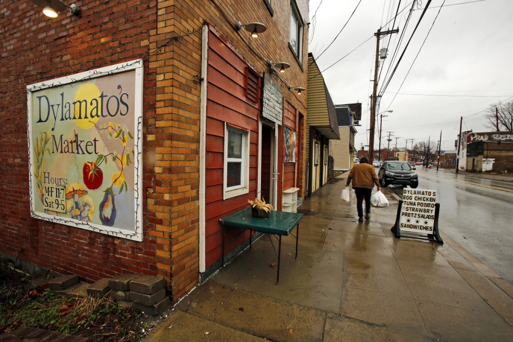 """In this March 1, 2018 photo, a customer leaves Dylamatos Market owned by Dianne Shenk in Hazelwood, Pa. About a quarter of Shenk's customers pay with benefits from the federal Supplemental Nutrition Assistance Program, so the government's proposal to replace the debit card-type program with a pre-assembled box of shelf-stable goods delivered to recipients worries her and other grocery operators in poor areas. """"These boxes will be full of shelf-stable items, the same things we're being told not to eat,"""" she said. (AP Photo/Gene J. Puskar)"""