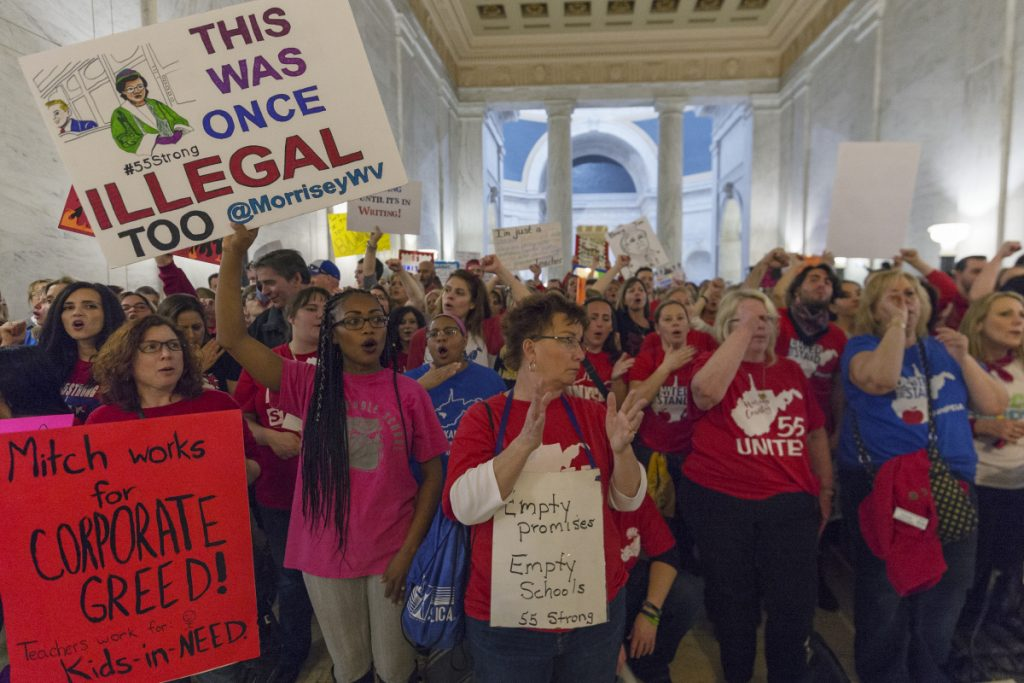 Thousands of teachers and school personnel demonstrate at the capitol in Charleston, W.Va., on Monday, the eighth school day of the statewide teachers' strike.