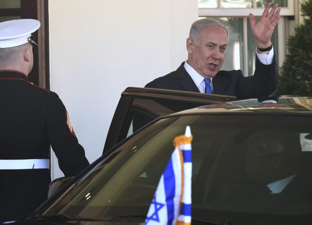 Israeli Prime Minister Benjamin Netanyahu waves as he leaves the White House in Washington on Monday following his meeting with President Trump.