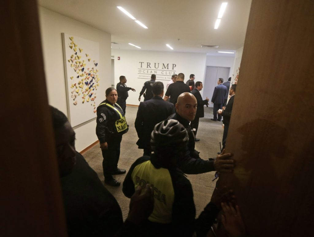 Panamanian police inside the Trump Ocean Club International Hotel and Tower in Panama City on Monday after a court there gave control of the property to majority owner Orestes Fintiklis.