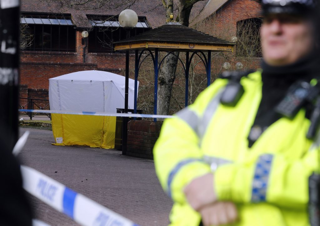 "A police tent covers the spot in Salisbury, England, where former Russian spy double agent Sergei Skripal and his daughter, Yulia were found unconscious on a park bench Sunday following exposure to an ""unknown substance."""