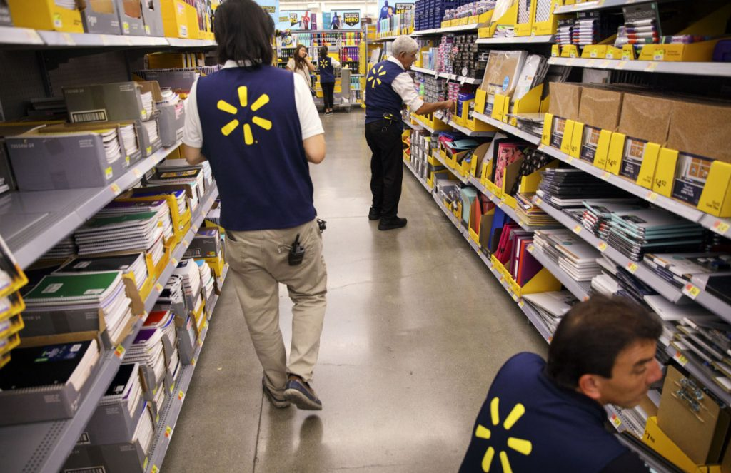 Walmart says it's paying out $400 million in bonuses and $300 million in raises because of the tax cut – but because of state minimum-wage hikes and a tight job market, it likely would have had to raise pay anyway.