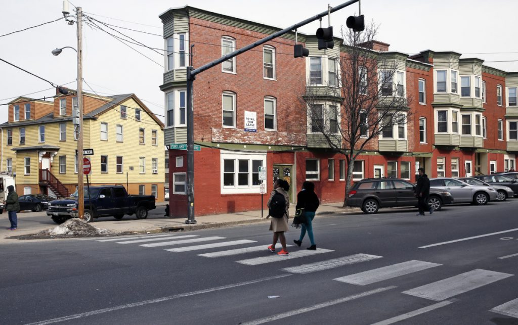 The new owner plans to develop properties close to a day shelter and soup kitchen – 19 Preble St., right, and 255 Oxford St., left. A reader says the changes in Bayside shouldn't leave the needy behind.