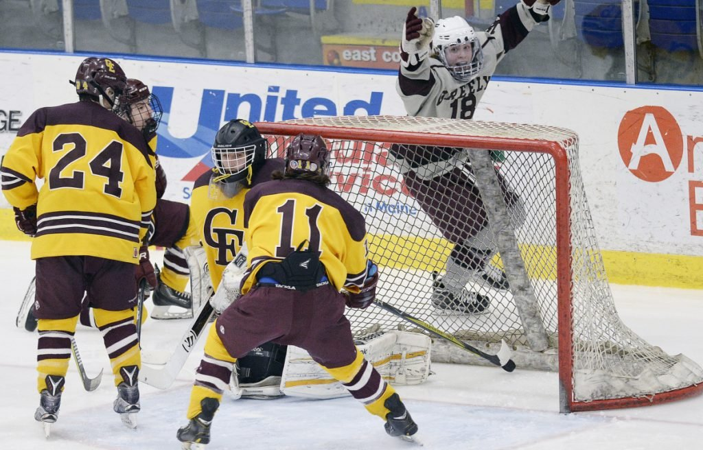 Greely's Jake MacDonald celebrates after scoring in the third period Tuesday in Lewiston. The goal turned out to be the winner.