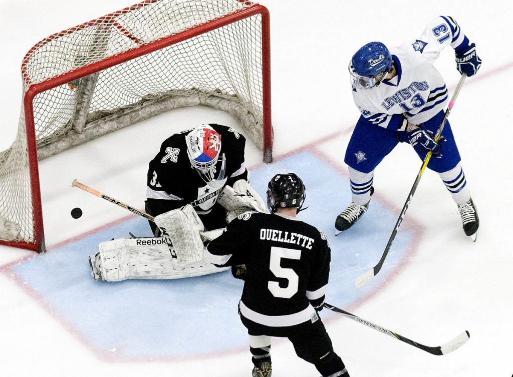 St. Dom's goalie Gaston Fuksa saves a shot by Caden Smith of Lewiston during the second period of the Class A North final Tuesday in Lewiston.