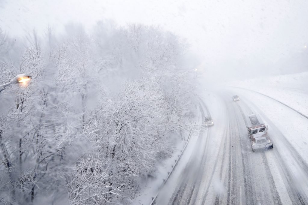 Vehicles travel northbound over a snow-covered Interstate 287 during a snowstorm Wednesday in Morristown, N.J.
