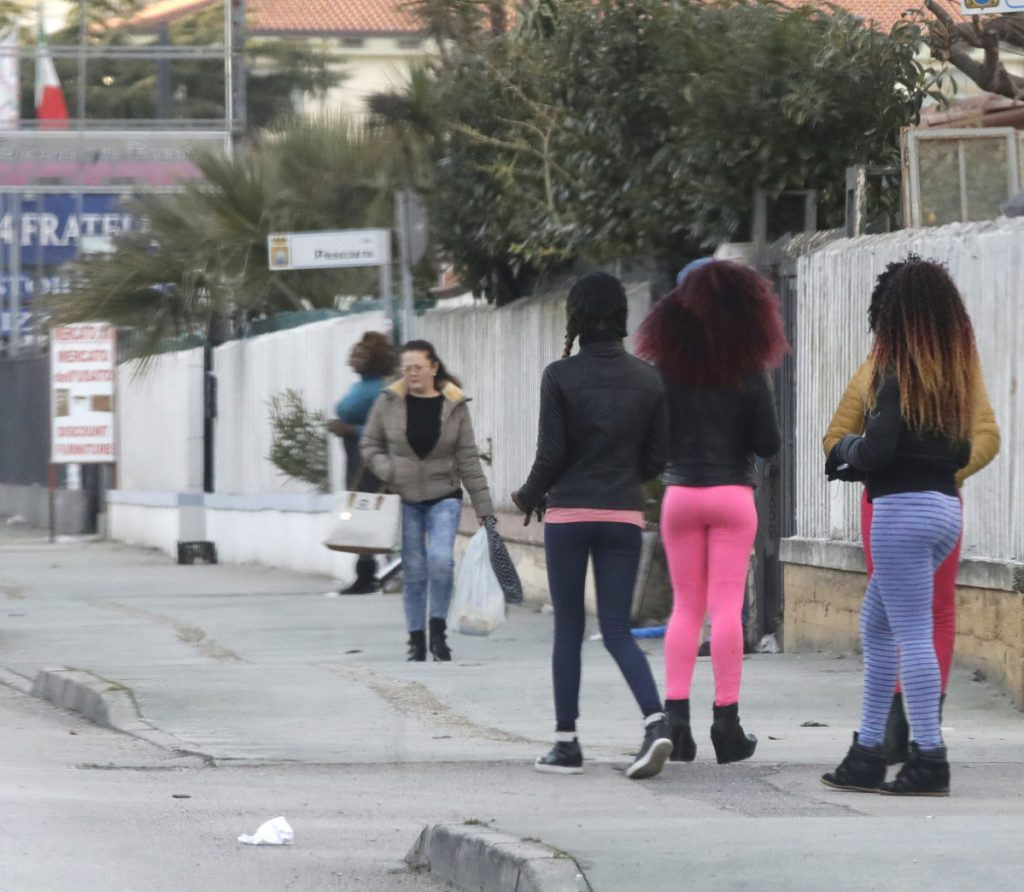 Nigerian prostitutes wait for clients in Castel Volturno, near Naples, Italy, last month. Nigerian teenagers and young women selling sex along the roadsides is becoming a common sight for motorists in Italy.