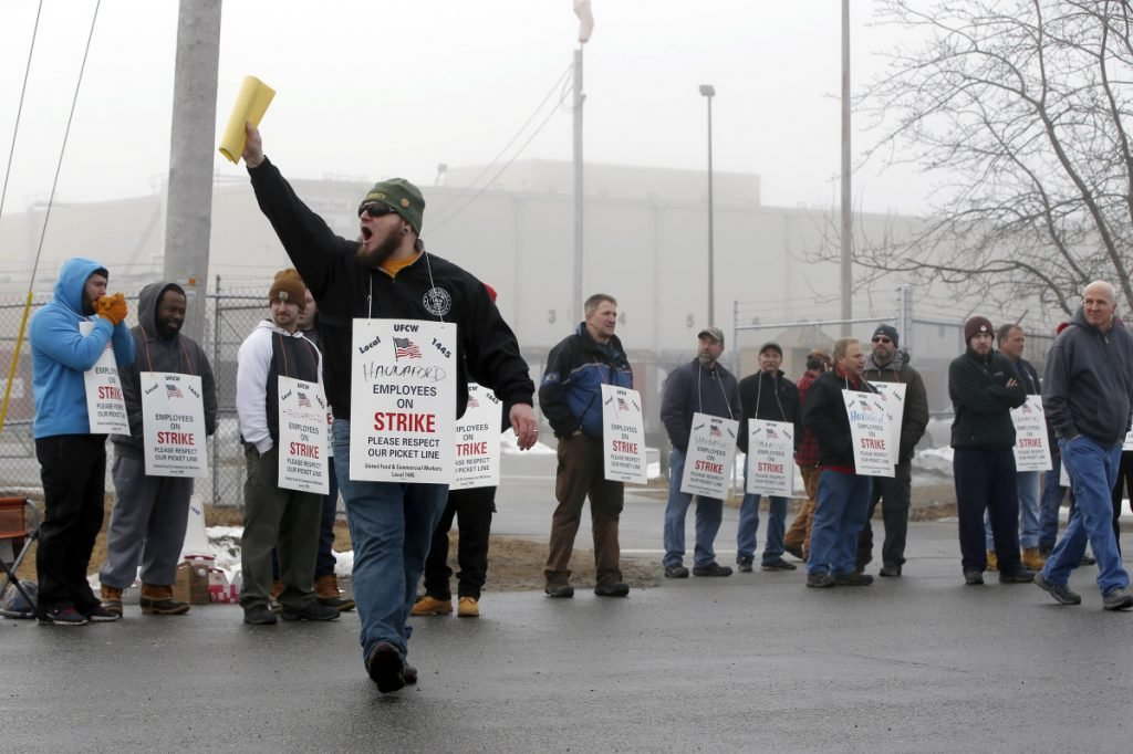 Pickets at the Hannaford distribution center in South Portland during the strike over wages and health care costs. A letter writer says employment-based health benefits go back to World War II to avoid wage controls.