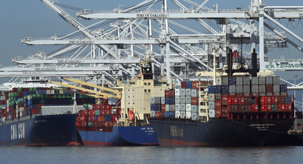 Container ships wait to unload their overseas cargo at the Port of Oakland on Wednesday. The White House is expected to make a final decision on Thursday on new tariffs, which could have a significant impact on both imports and exports.