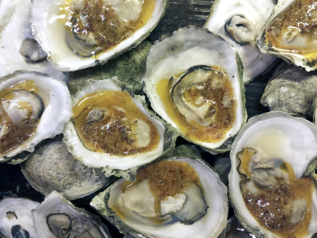 Oysters dolloped with maple-chipotle compound butter.