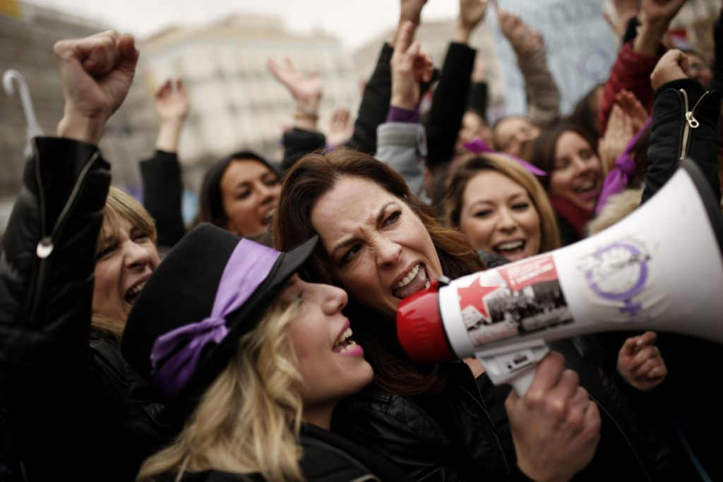 Women gather at a protest at Sol square on International Women's Day in Madrid on Thursday to speak out against gender violence and inequality.