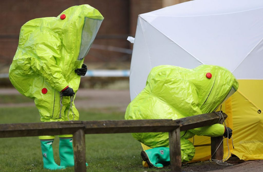 Personnel in hazmat suits work at the scene of a nerve agent attack on a former Russian spy and his daughter in Salisbury, England, on Sunday.