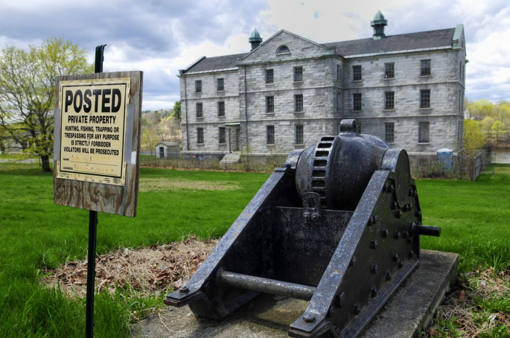 The vacant Kennebec Arsenal stands on the east bank of the Kennebec River in Augusta, where a group proposes to build a substance abuse treatment facility for veterans.