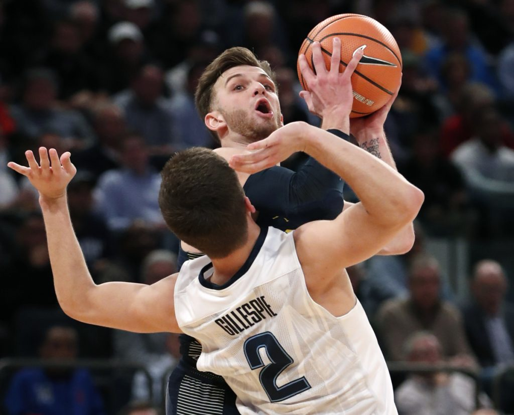 College basketball: North Carolina rallies past Walker, Miami